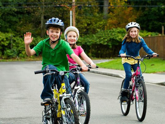 Photograph of kids on bicycles